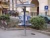 After you, 2012, maintien d'une flaque d'eau au pied d'une cabine téléphonique devant la mairie du 18ème à Paris pendant la durée de l'exposition (41 jours)
